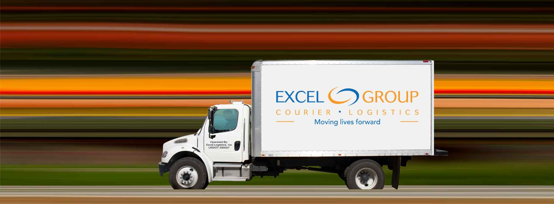 Excel Courier and Logistics truck driving down the road