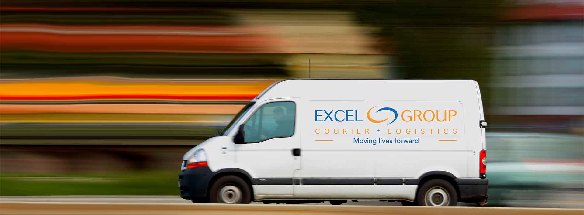 Excel delivery van driving down the road