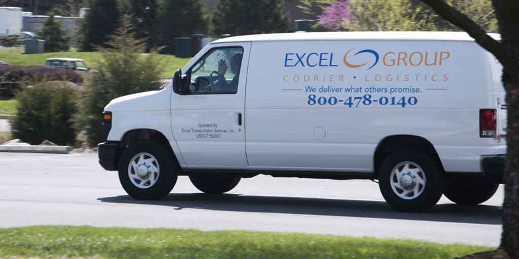 Excel Courier Van driving on the road